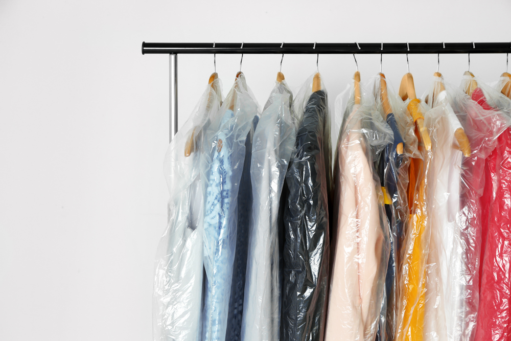 Hangers,with,clean,clothes,in,laundry