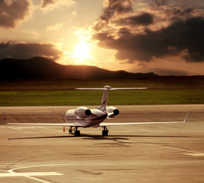 Close,up,private,jet,airplane,parked,at,airport,over,cloudy
