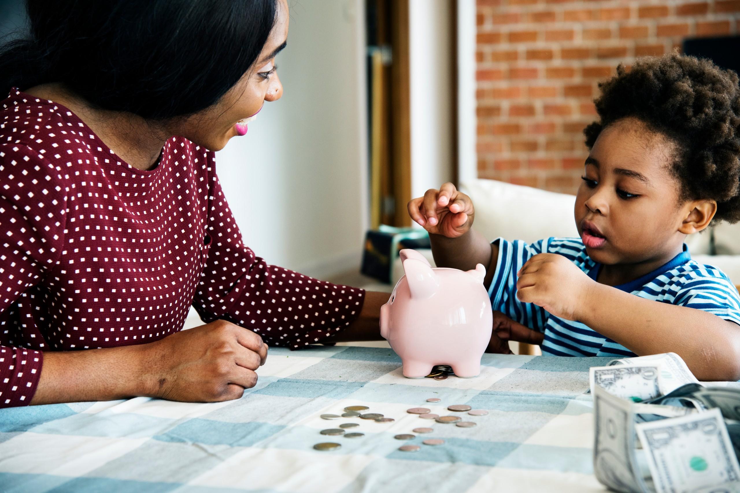 Mom,and,son,saving,money,to,piggy,bank